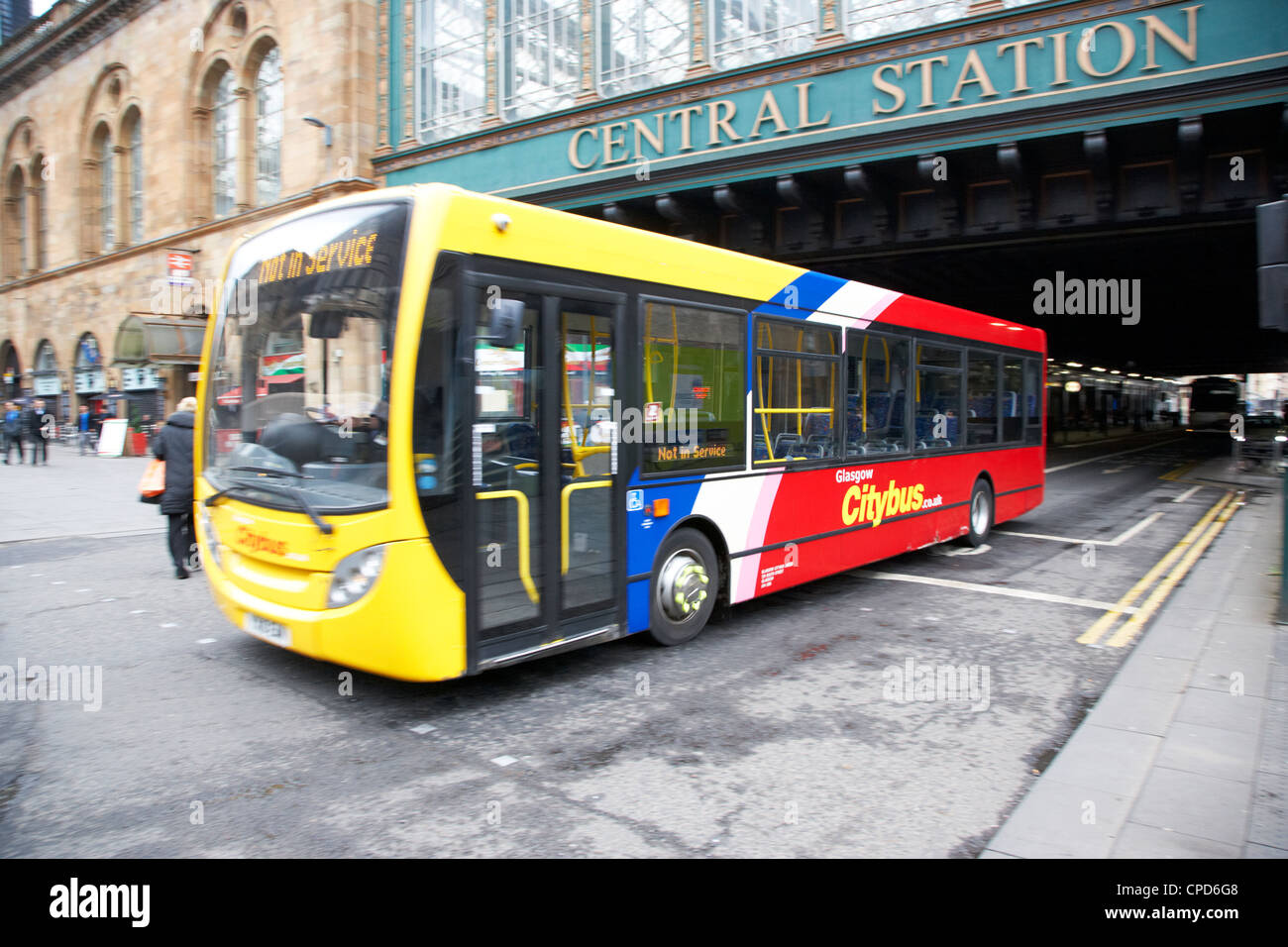 Glasgow citybus moving under central station bridge in the city centre Scotland UK deliberate motion blur - Stock Image