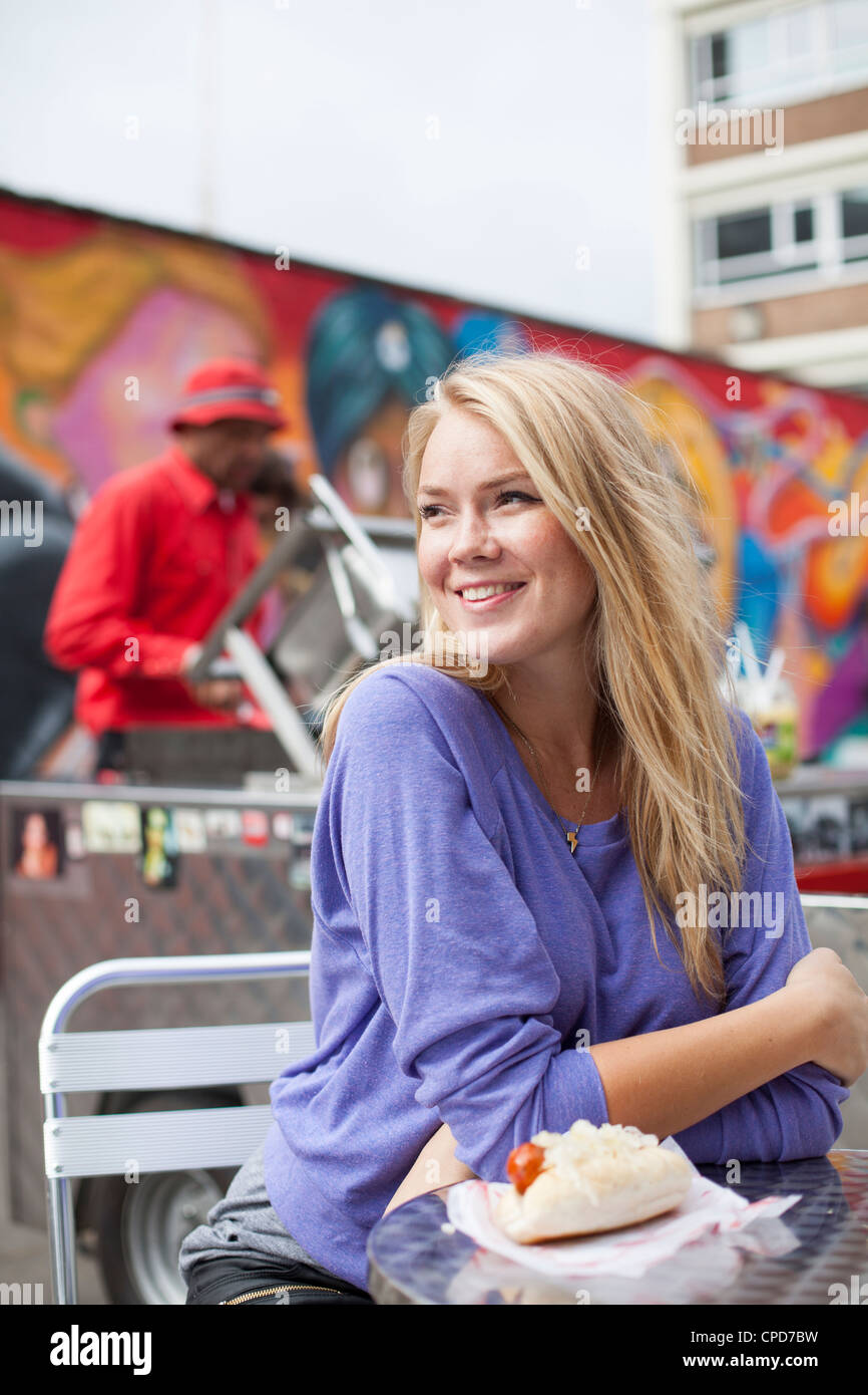Woman with street food East London - Stock Image