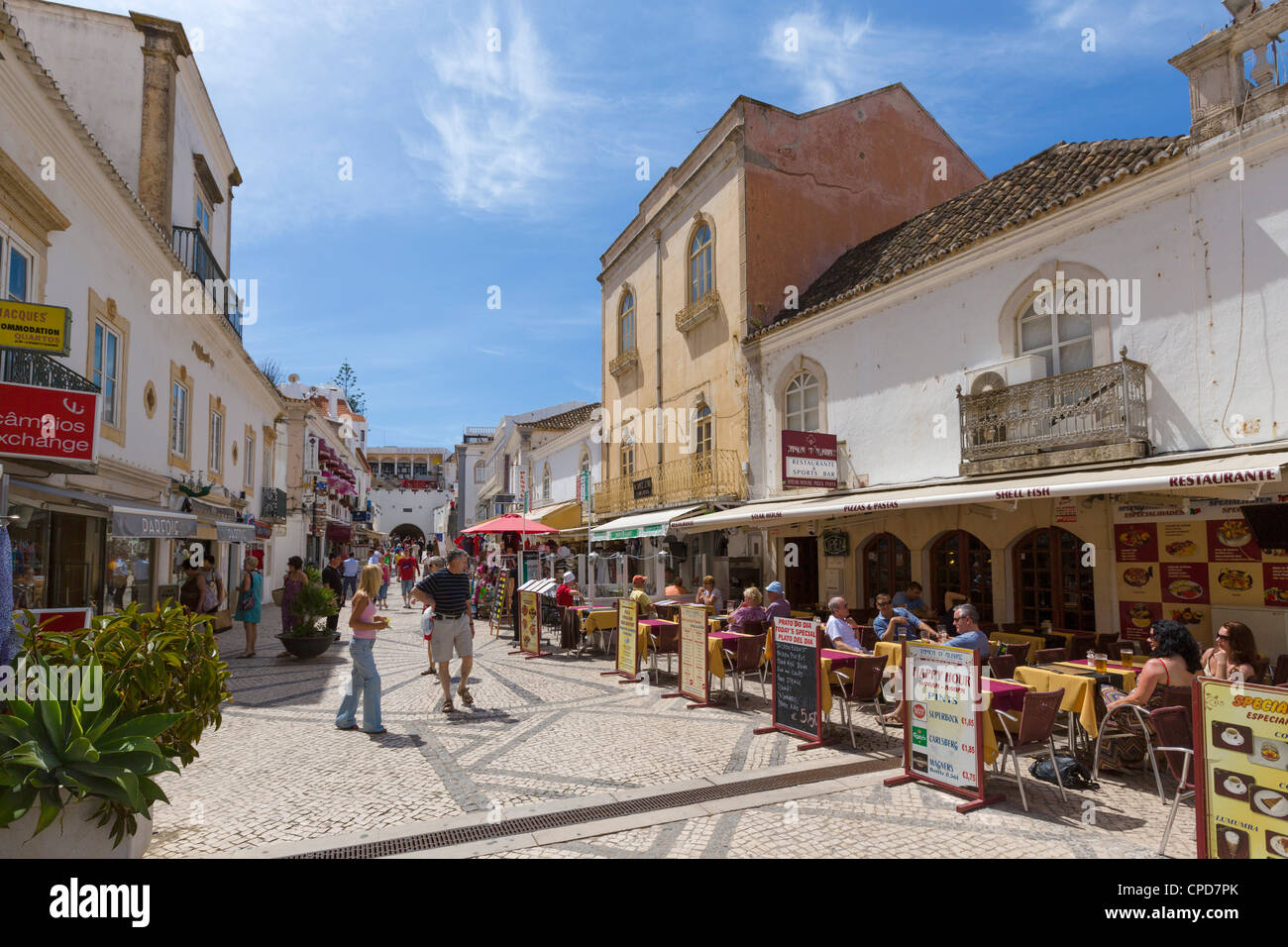 Shops and restaurants on Rua 5 de Outubro in the old town centre, Albufeira, Algarve, Portugal - Stock Image