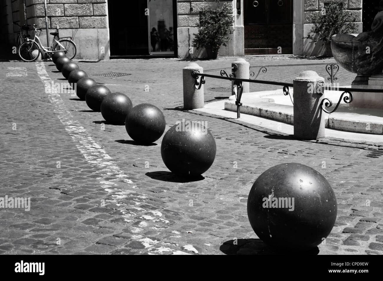 Street furniture, row of metal balls marking side of street. - Stock Image