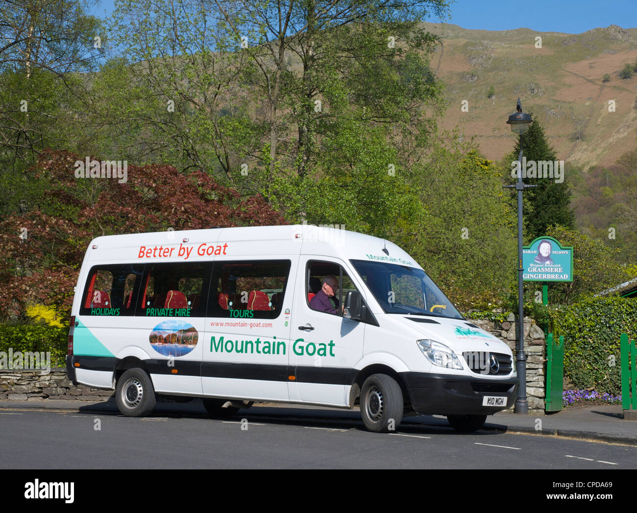 Mountain Goat minibus in the village of Grasmere, Lake District National Park, Cumbria, England UK - Stock Image