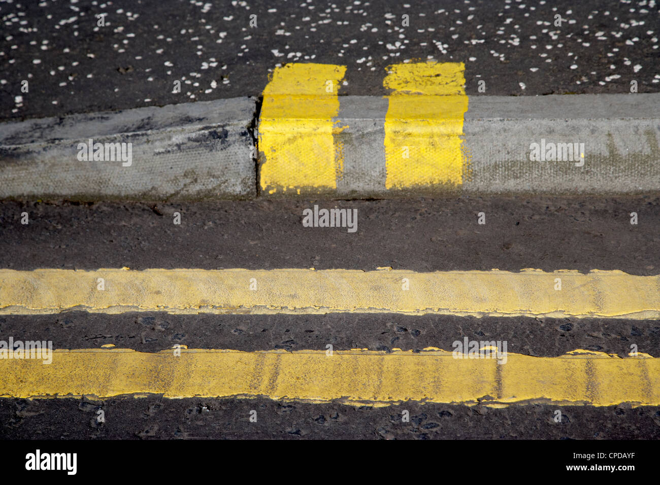 double yellow lines road and no loading kerb pavement markings in Glasgow Scotland UK - Stock Image