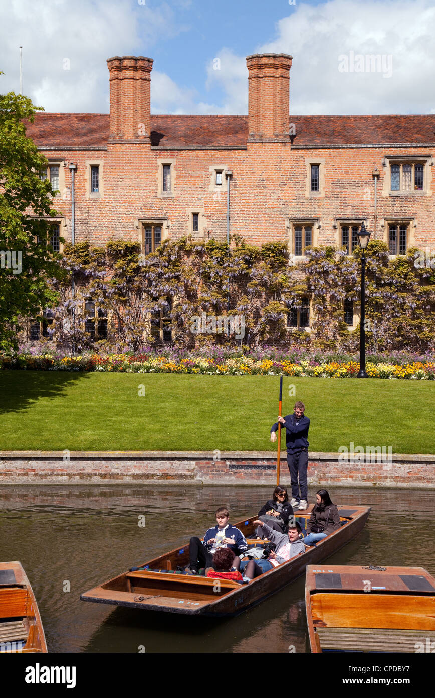 People punting on the river Cam by Magdalene College, Cambridge UK - Stock Image