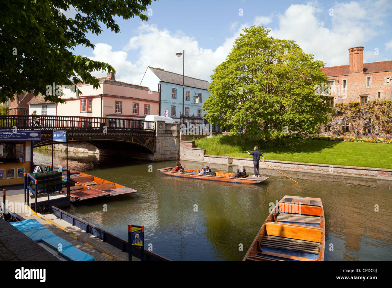 People punting on the river Cam at Magdalene Bridge, Cambridge UK - Stock Image