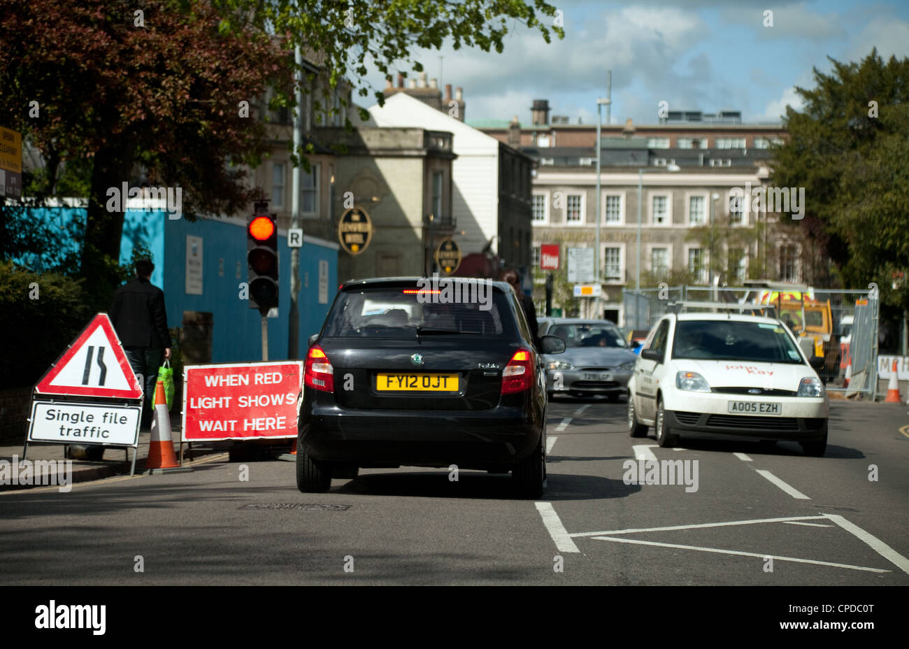 Cars stopped at traffic lights for temporary road works, Lensfield Rd, Cambridge UK - Stock Image