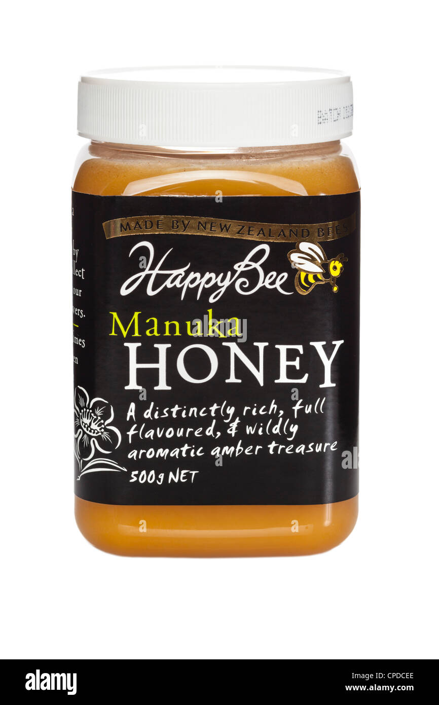 A jar of New Zealand Happy Bee Manuka Honey, famed for its anti-bacterial properties. - Stock Image