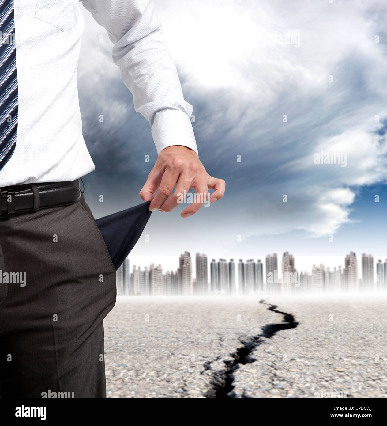 business man showing his empty pockets and financial crisis concept - Stock Image
