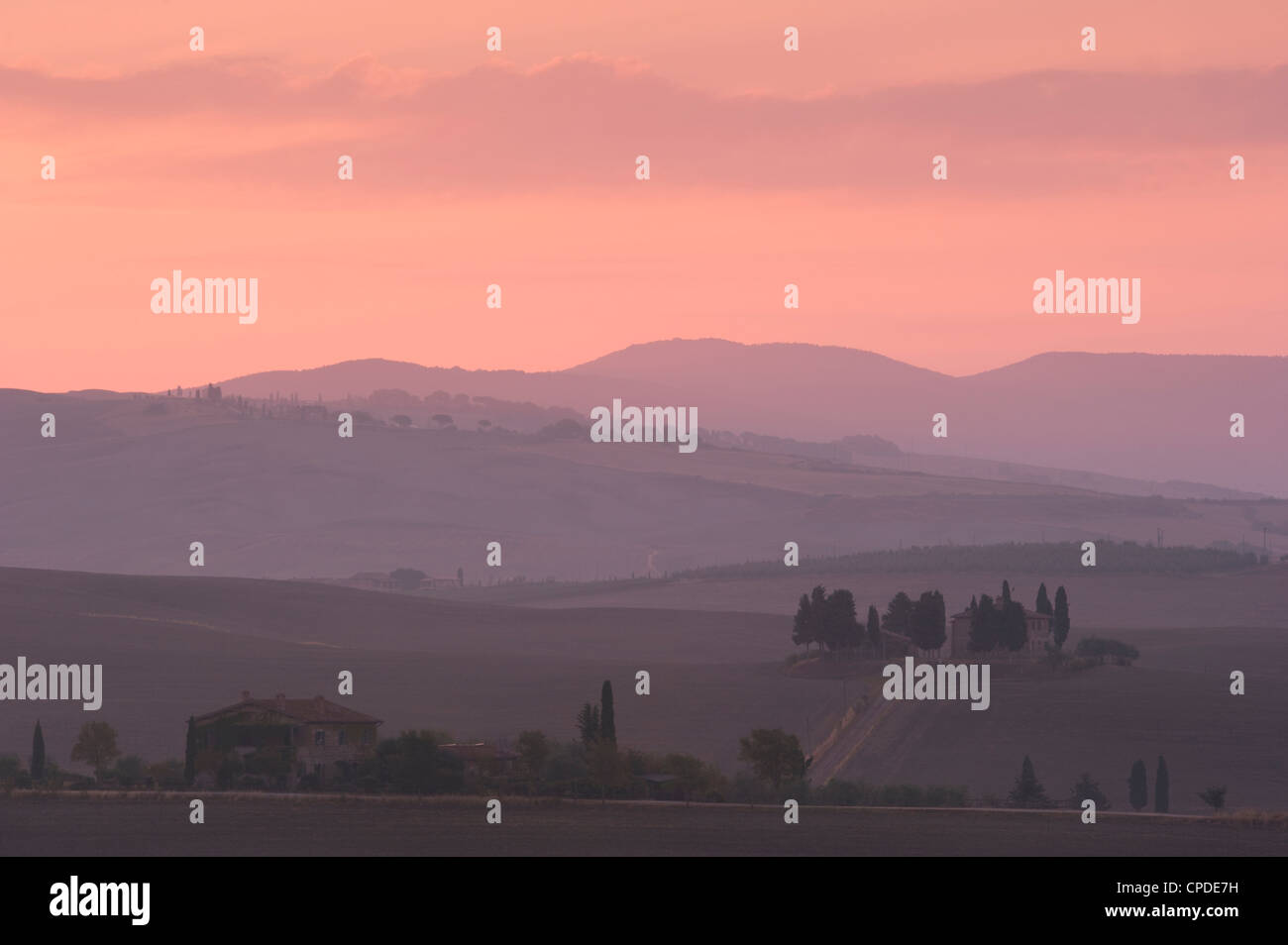 A view at dawn toward Pennella a stone farmhouse in the Val d'Orcia, UNESCO World Heritage Site, Tuscany, Italy, - Stock Image