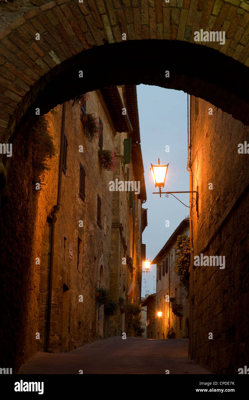 An early morning view through a stone arch in the hilltop town of Pienza, Val d'Orcia, Tuscany, Italy, Europe Stock Photo