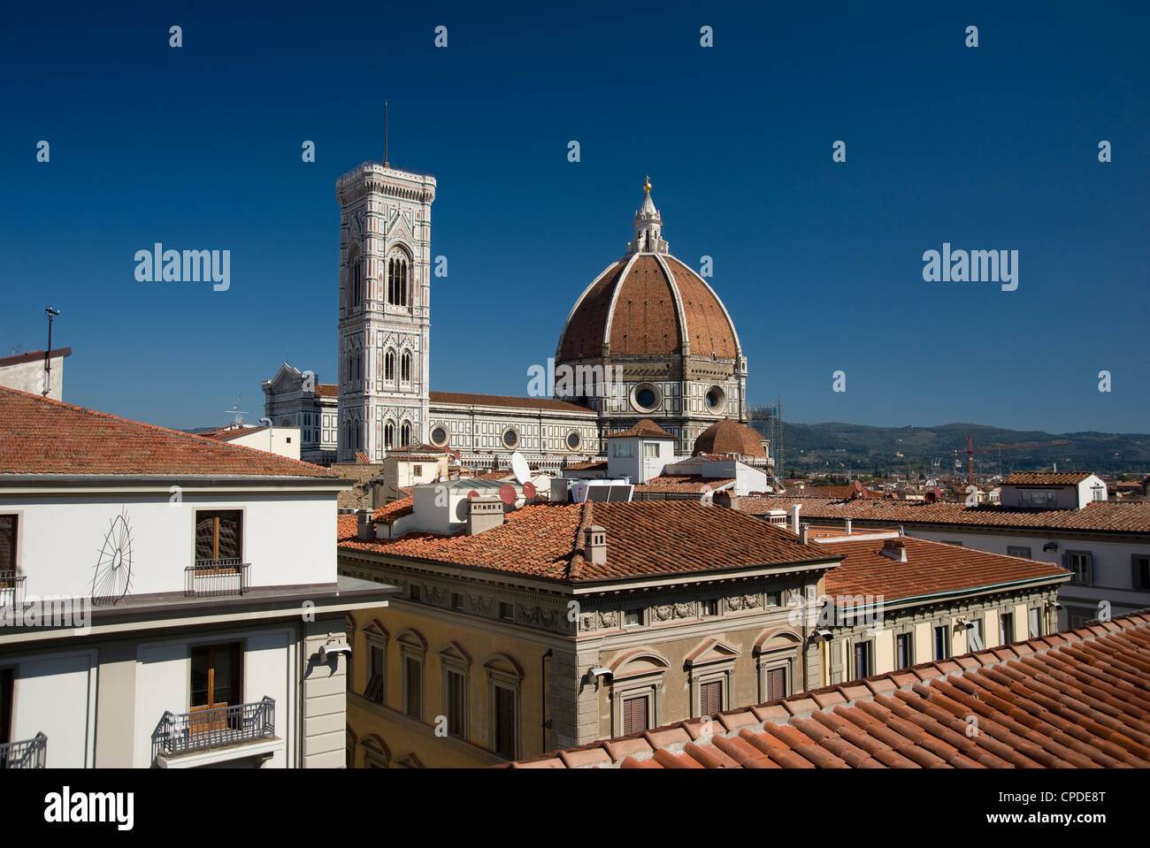 A view over teracotta rooftops to the Duomo and Campanile, Florence, UNESCO World Heritage Site, Tuscany, Italy, - Stock Image