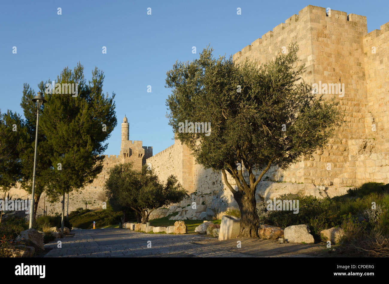 View at sunset of the city walls promenade with Tower of David in background, Old City, Jerusalem, Israel, Middle - Stock Image