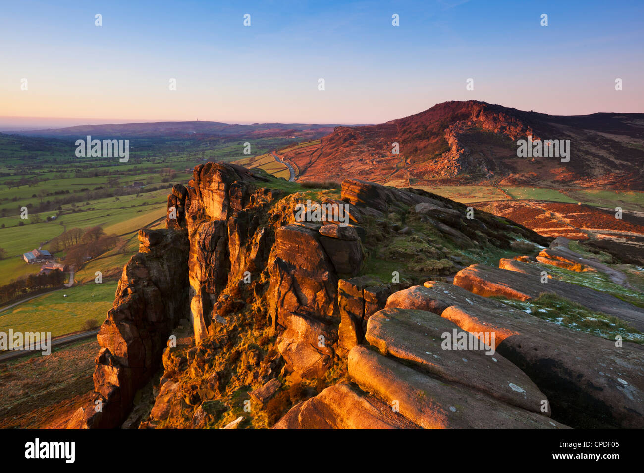 Winter sunset on the gritstone rock formations of Hen Cloud in the Roaches, Staffordshire, England, United Kingdom, - Stock Image