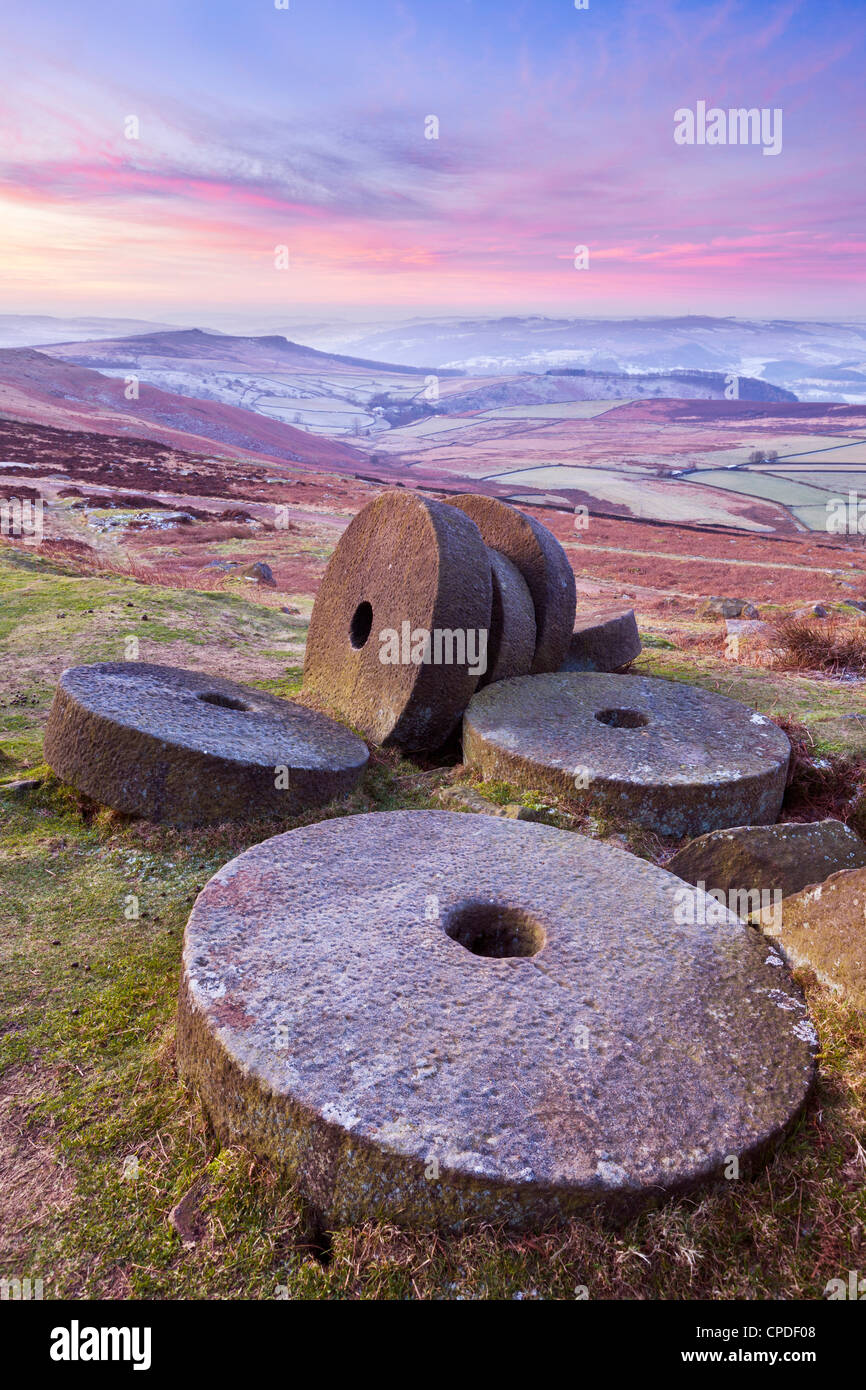 Stanage Edge wheelstones (millstones) and frosty winter moorland sunrise, Peak District National Park, Derbyshire, Stock Photo