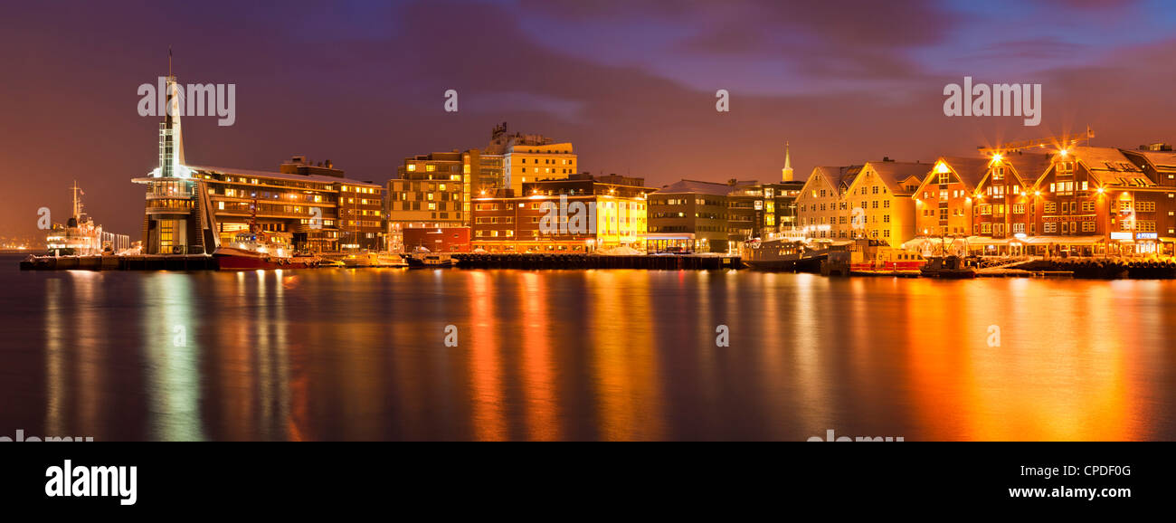 Arctic city of Tromso, harbour, port and waterfront warehouses, panorama at night, Tromso, Troms, North Norway, - Stock Image