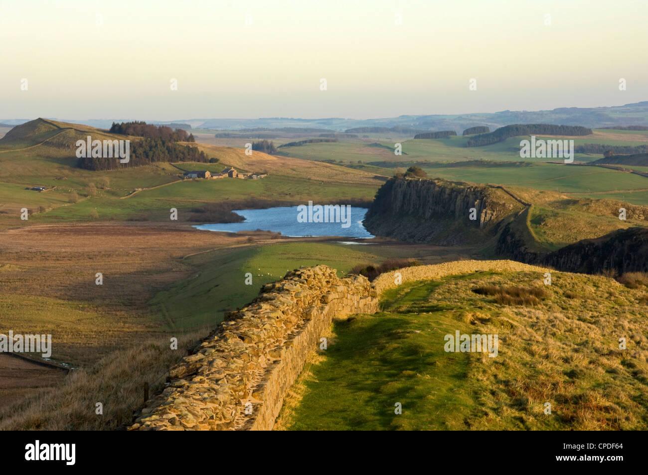 Towards sunset, view east along Hadrians Wall, Northumbria, England, UK - Stock Image