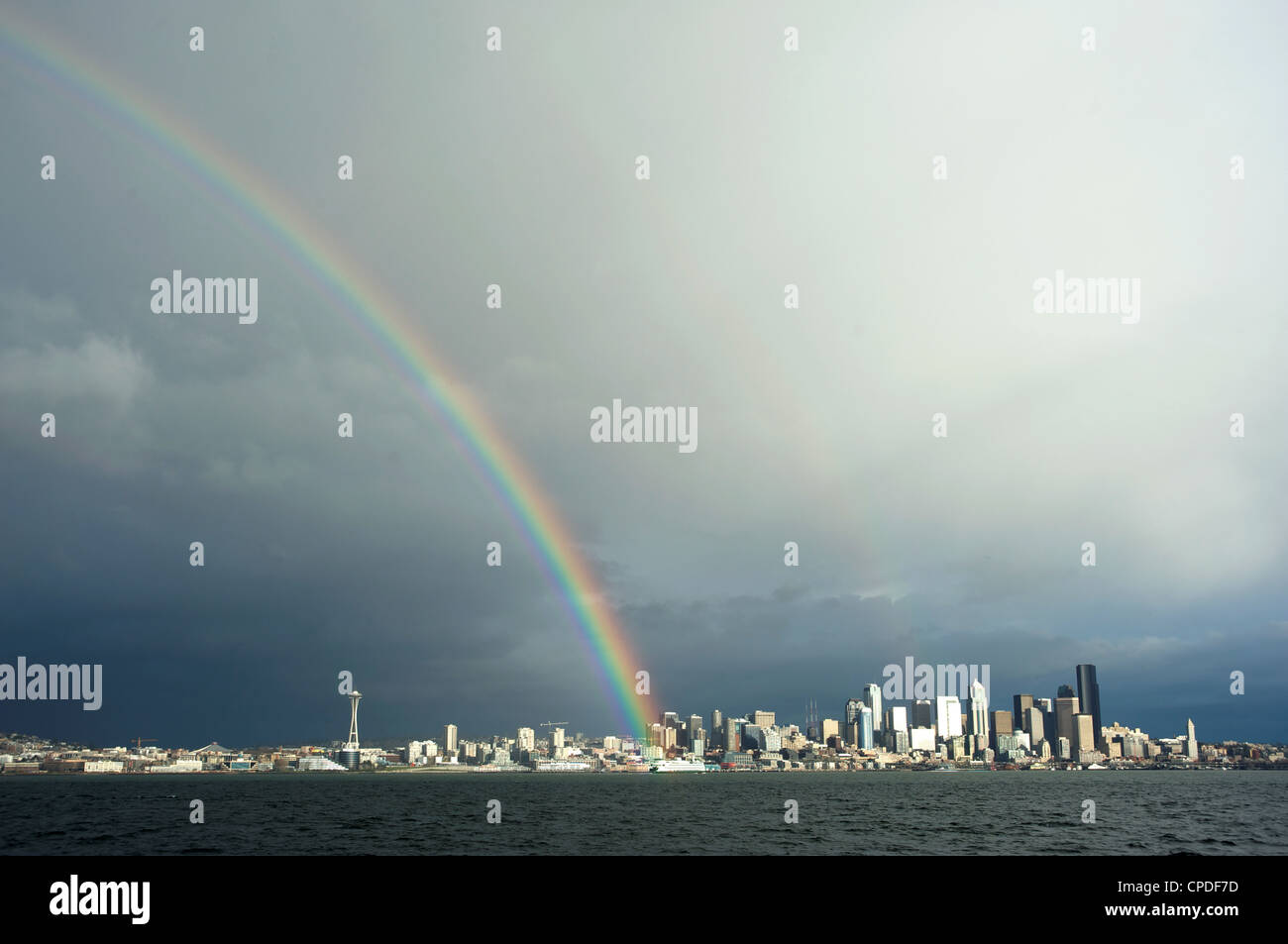 Washington State Ferry in the Puget Sound with the Seattle skyline in the background, Seattle, Washington, USA - Stock Image