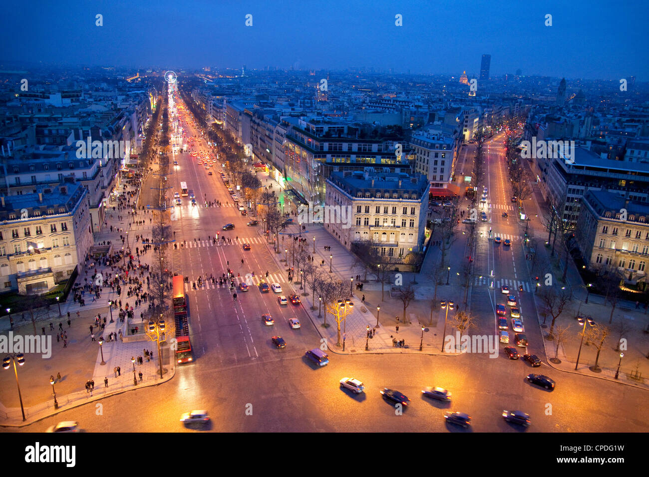 The Champs Elysees at night from the Arc de Triomphe, Paris, France, Europe - Stock Image