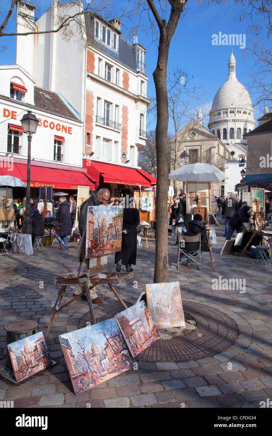 Paintings for sale in the Place du Tertre with Sacre Coeur Basilica in distance, Montmartre, Paris, France, Europe - Stock Image