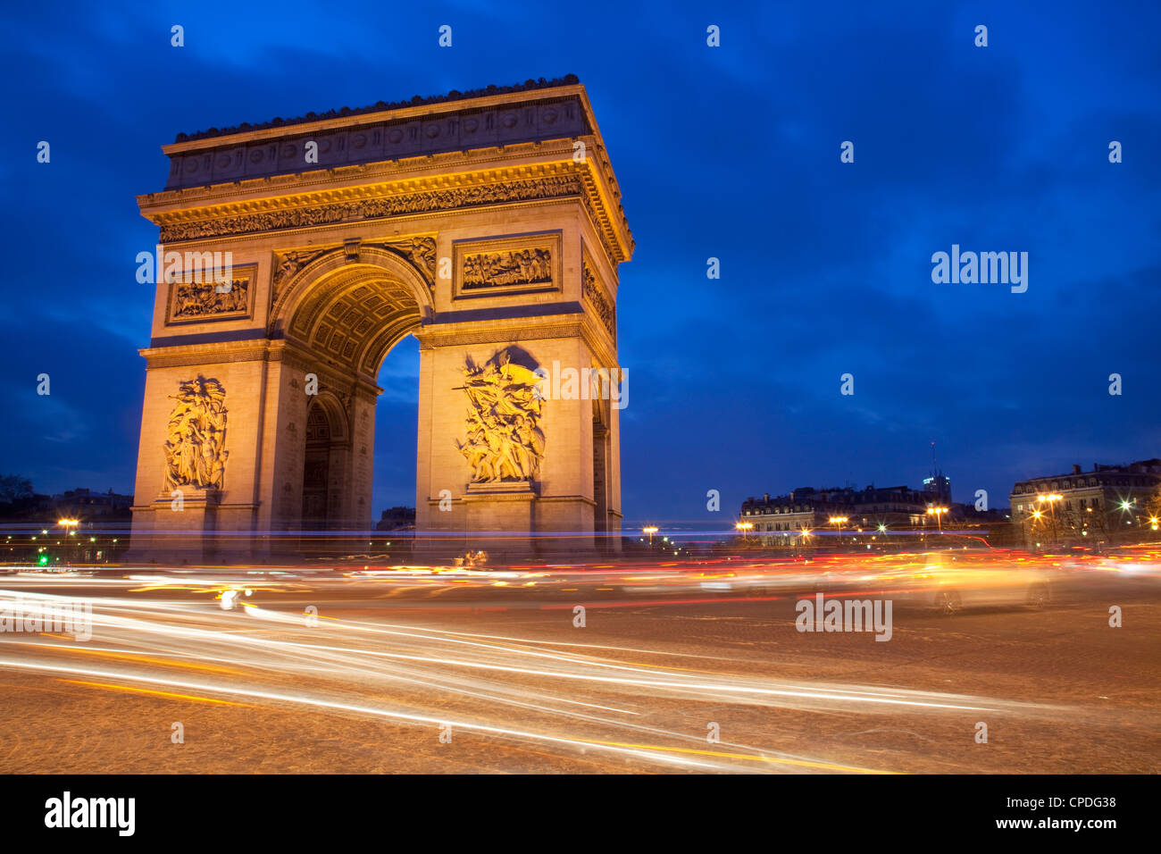 Traffic at the Arc de Triomphe at night, Paris, France, Europe - Stock Image
