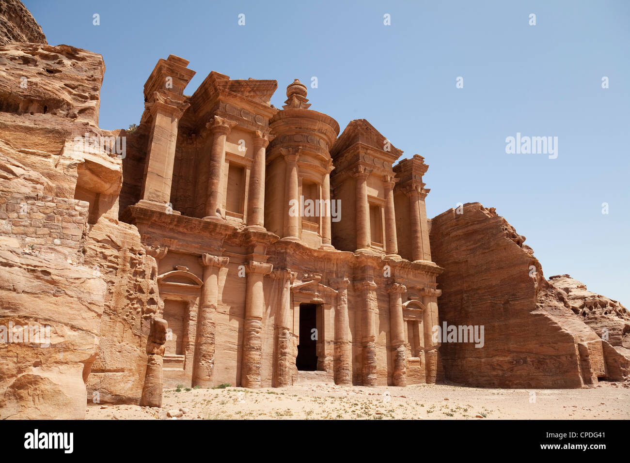 The facade of the Monastery carved into the red rock at Petra, UNESCO World Heritage Site, Jordan, Middle East - Stock Image