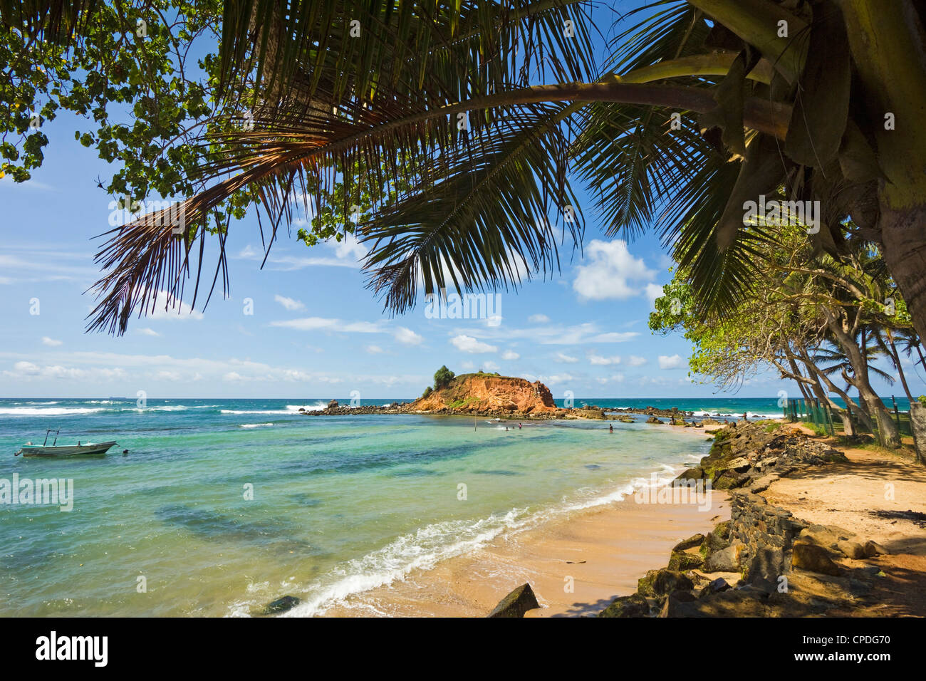 The eastern point of this beautiful south coast whale watching surf beach at Mirissa, Matara, Southern Province, - Stock Image