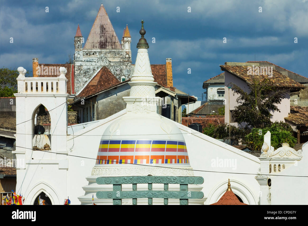 Shri Sudarmalaya Buddhist Temple and All Saints Anglican Church inside the old colonial Dutch Fort, Galle, Sri Lanka, - Stock Image