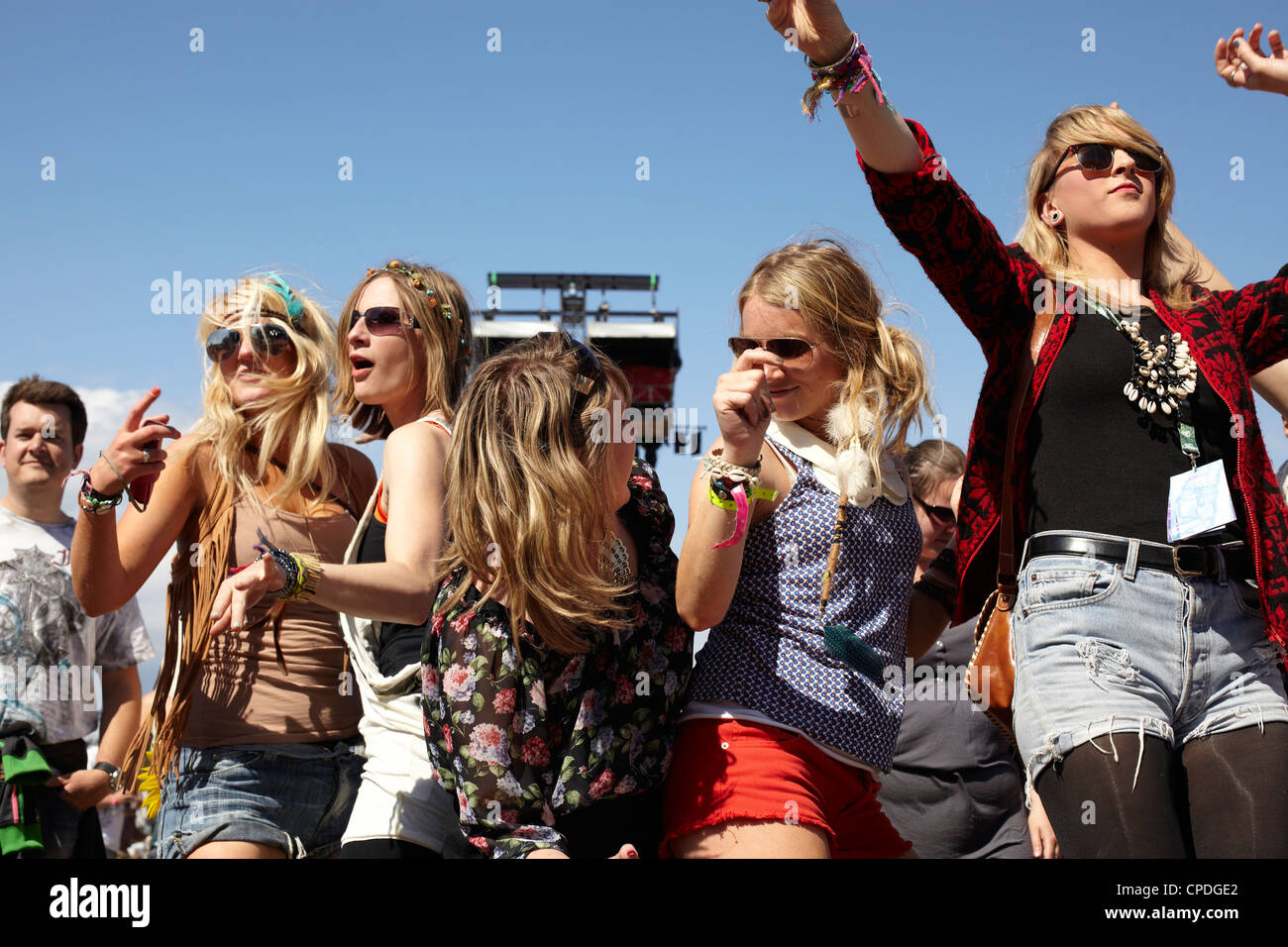 Girls cheering hysterically at a gig at a music festival - Stock Image