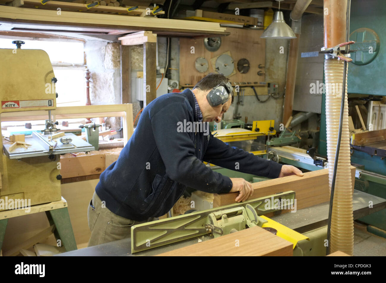 A carpenter in his workshop - Stock Image