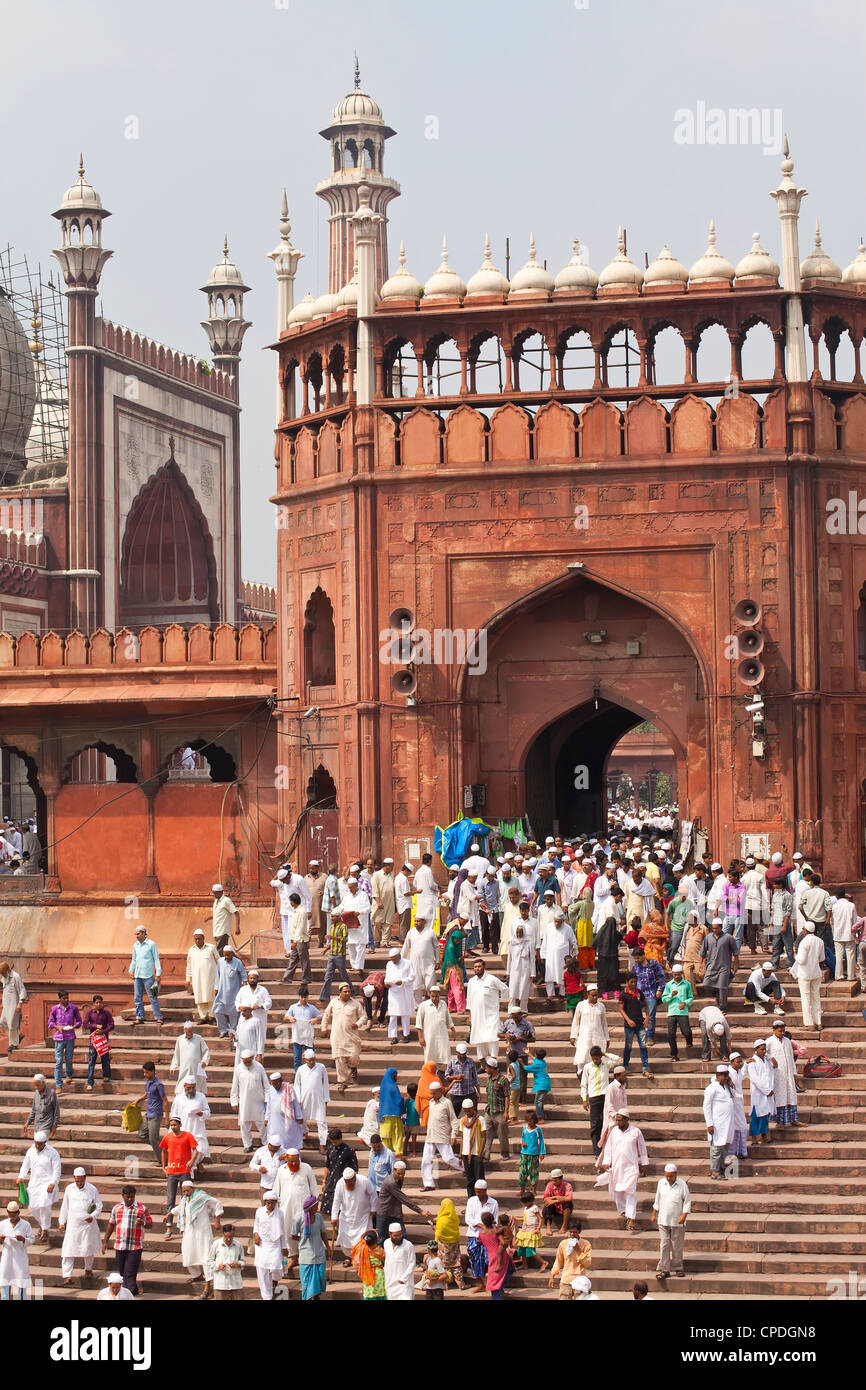 People leaving the Jama Masjid (Friday Mosque) after the Friday Prayers, Old Delhi, Delhi, India, Asia - Stock Image