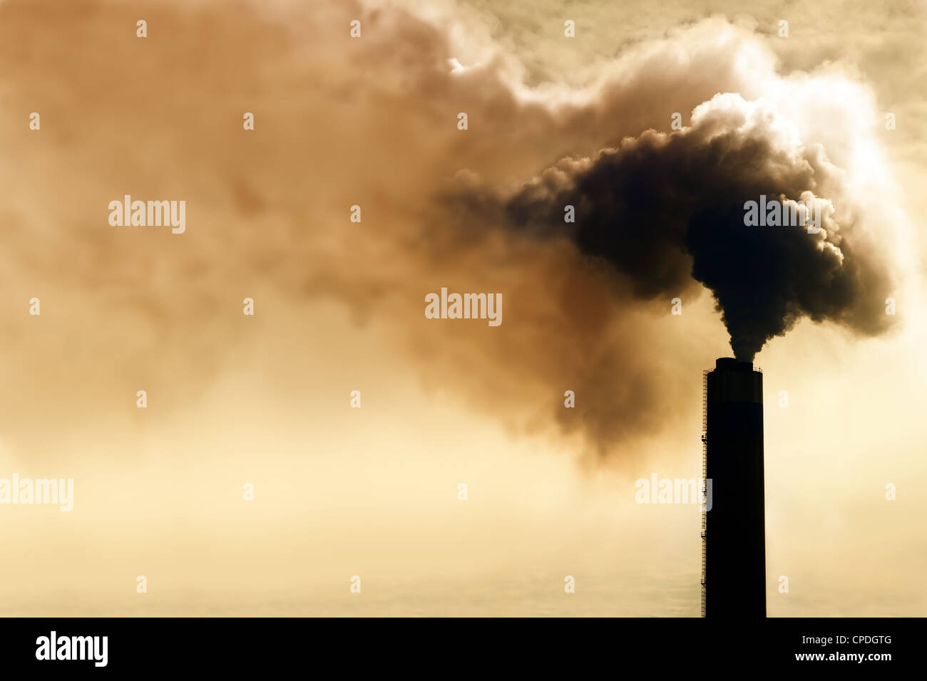 Heavy smoke from industrial chimney polluting the environment - Stock Image
