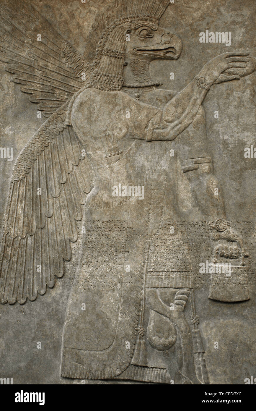 Relief depicting a Eagle-headed protective spirit. 865-860 BC. From Northwest Palace. Nimrud. Stock Photo
