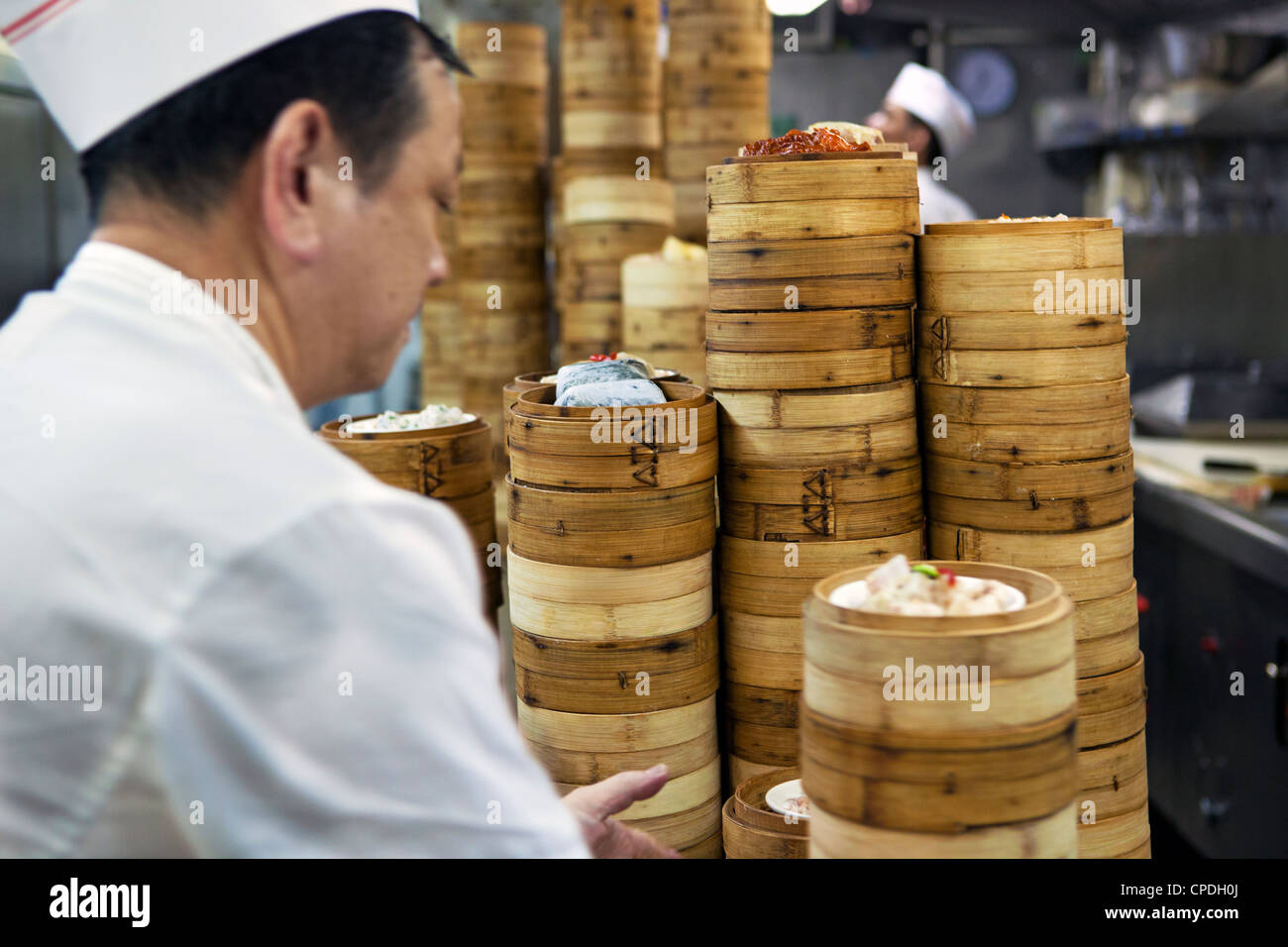 Dim sum preparation in a restaurant kitchen in Hong Kong, China, Asia - Stock Image