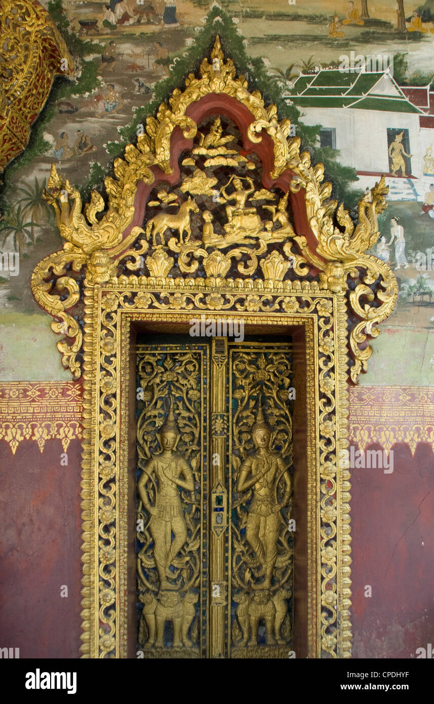 Temple door with murals, Wat Paphaimsaiyaram, Luang Prabang, Laos, Indochina, Southeast Asia, Asia - Stock Image