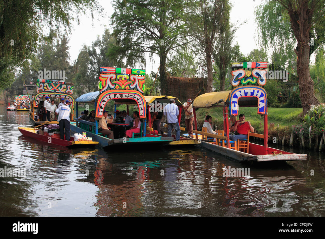 Brightly painted boats, Xochimilco, Trajinera, Floating Gardens, Canals, Mexico City, Mexico, North America - Stock Image