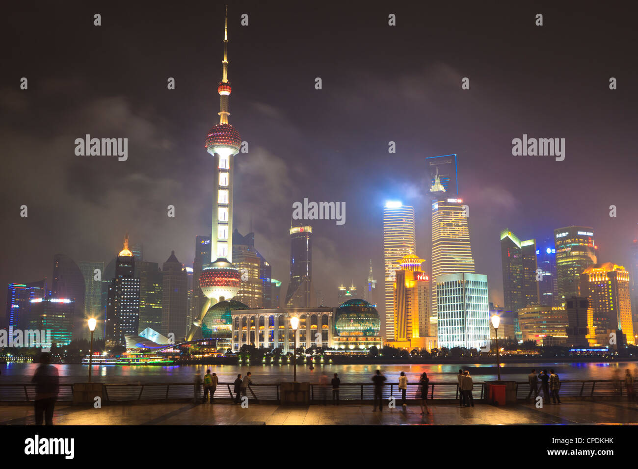 Pudong skyline at night across the Huangpu River, Oriental Pearl tower on left, Shanghai, China, Asia - Stock Image