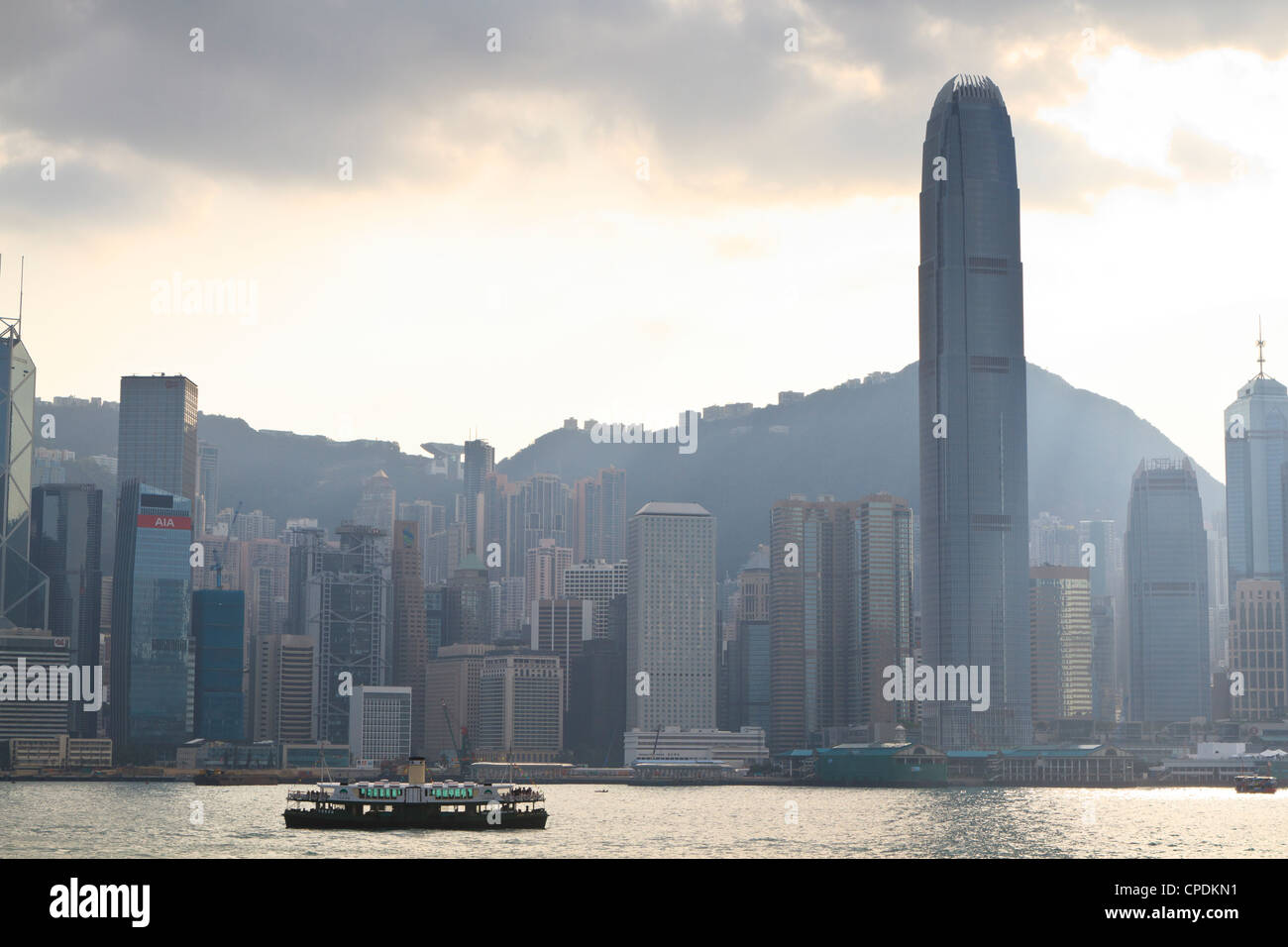Star ferry on Victoria Harbour with the skyscrapers of Hong Kong Island behind, Hong Kong, China, Asia Stock Photo