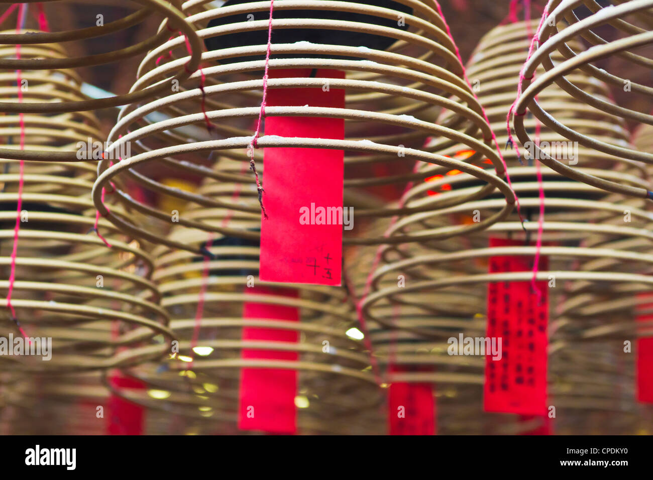 Incense coils and prayers written on red tags in the Man Mo Temple, Hong Kong, China, Asia - Stock Image
