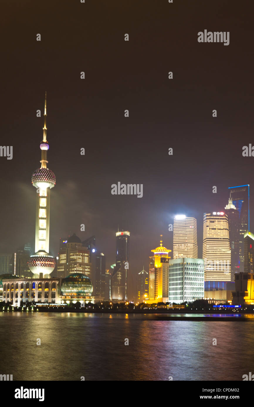 Pudong financial district and Oriental Pearl Tower across the Huangpu River, Shanghai, China, Asia - Stock Image