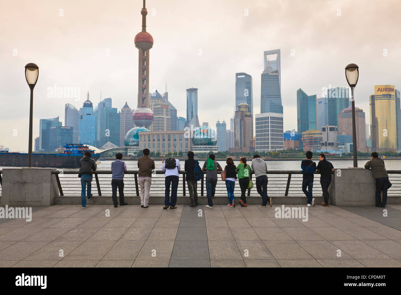 People viewing the Pudong skyline and the Oriental Pearl Tower from the Bund, Shanghai, China, Asia - Stock Image