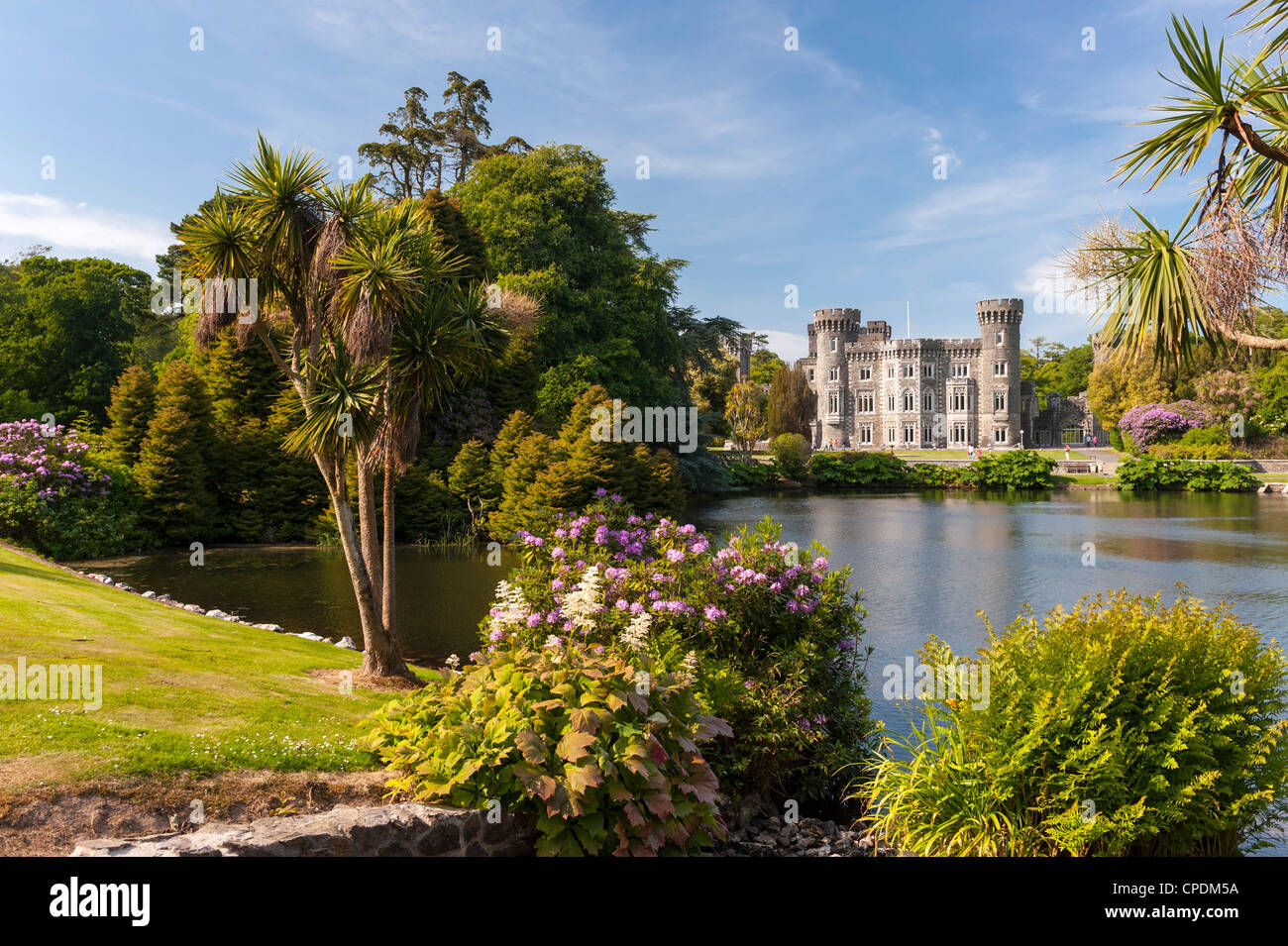 Historic Ireland - View across the lake to Johnstown Castle a beautiful Irish house, County Wexford, Ireland in - Stock Image