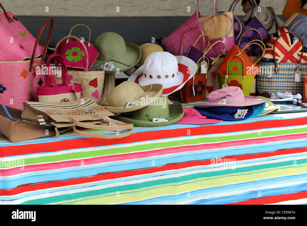 Colourfull summer hats on sale at market - Stock Image