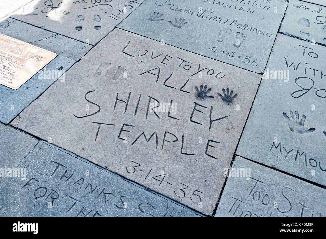 Shirley Temple's hand and foot prints on Walk of Fame, Hollywood Boulevard, Los Angeles, California, USA - Stock Image