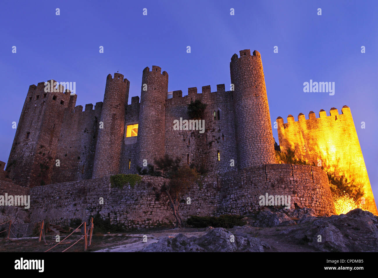 Obidos castle, today used as a luxury Pousada hotel, partially illuminated at night, Obidos, Estremadura, Portugal, - Stock Image