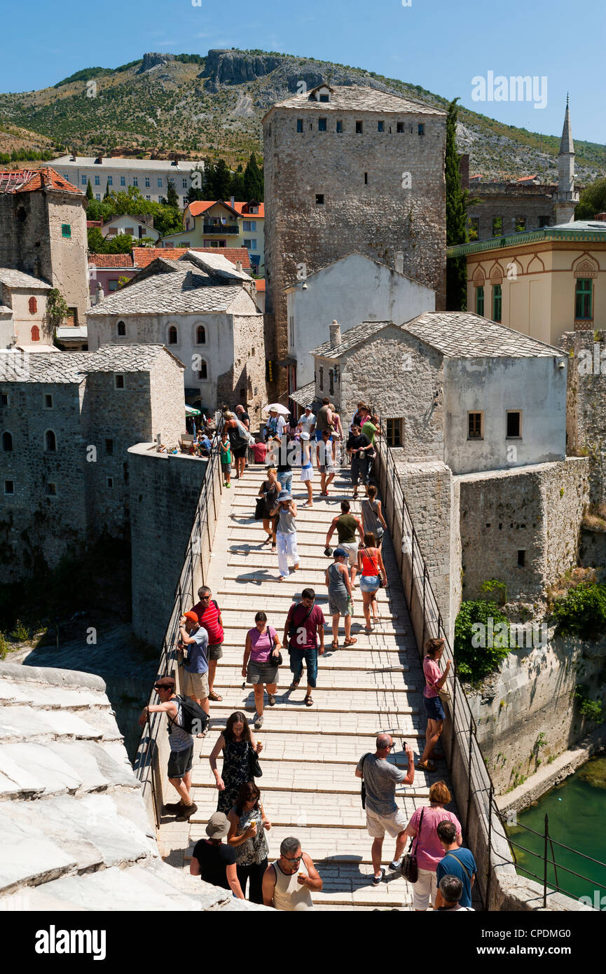 Tourists on Stari Most (Old Bridge), UNESCO World Heritage Site, Mostar, municipality of Mostar, Bosnia and Herzegovina, - Stock Image