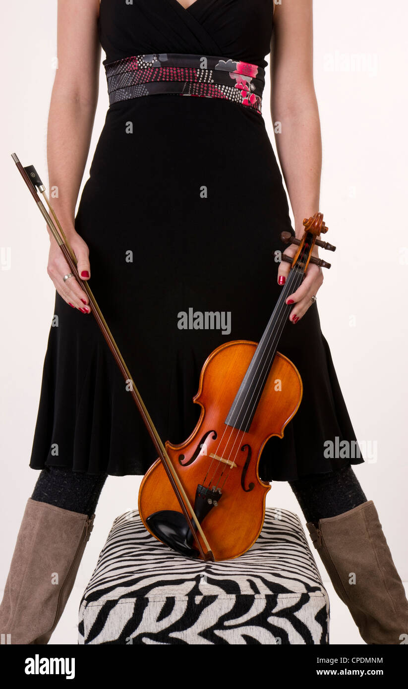 A musician hols her Bow and Violin - Stock Image