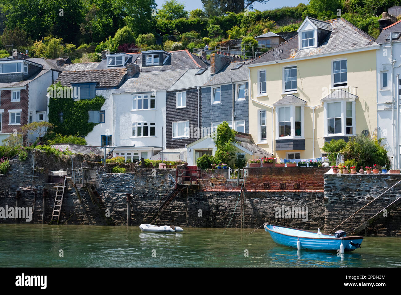 Houses on the waters edge in Fowey, Cornwall, England, United Kingdom, Europe - Stock Image