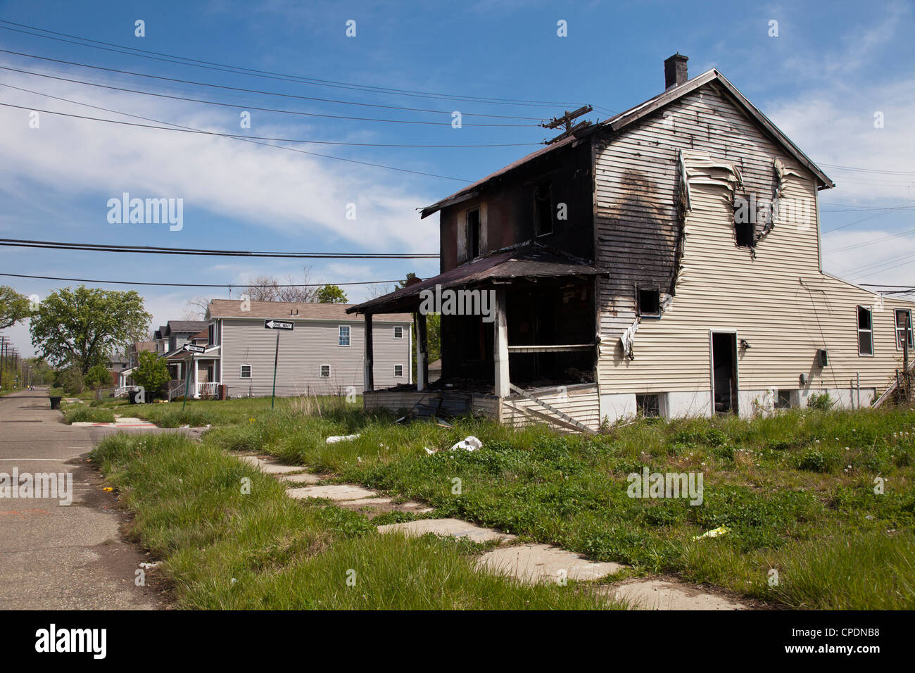 Burned out house in neighborhood of Detroit, Michigan - Stock Image