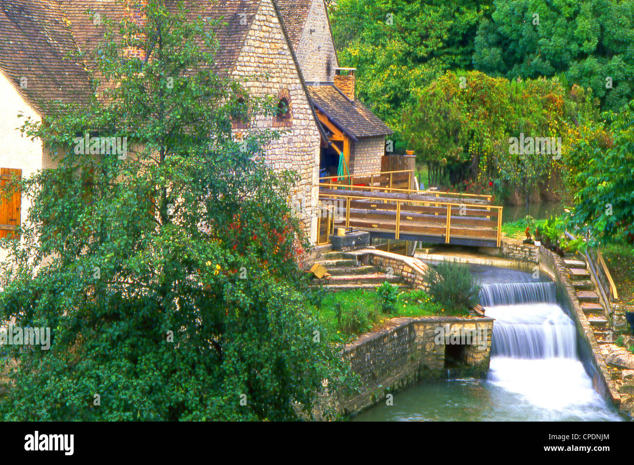 Image of an Old Mill with a waterfall in the town of Avallon in the Burgundy Region of France - Stock Image