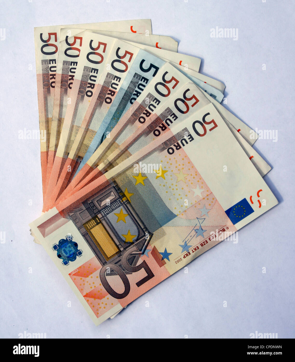 50 Euro notes fanned out with a fiver in the middle - Stock Image