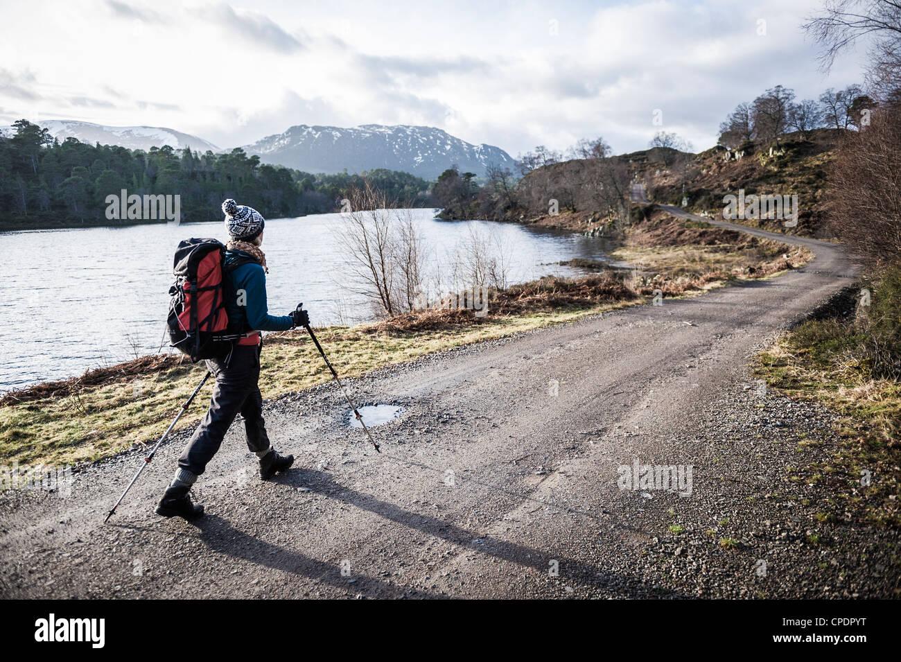 Walker walking around Loch Affric, Glen Affric, Highlands, Scotland, UK - Stock Image